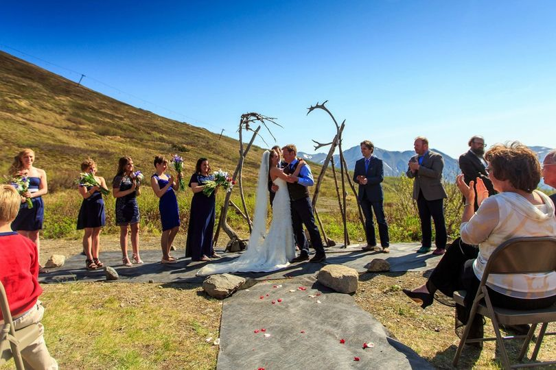 Ceremony on the lawn with beautiful background views