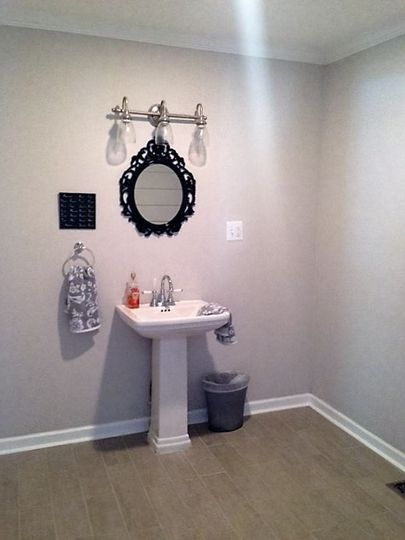 Half bath is very spacious and handicapped accessible. Located directly off of the main area.