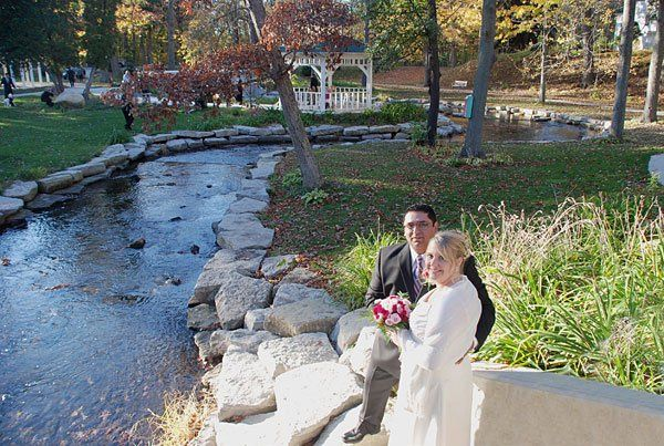 Molly and Norbert pose by the riverside after their wedding ceremony performed by Rev. Misty Urban....