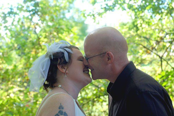 Dannial and Duncan share a kiss as the pose for photos after their elopement ceremony at the...