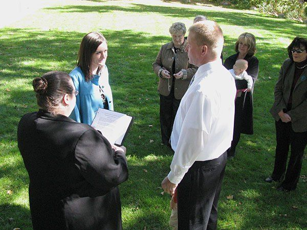 Rev. Misty Urban performs an outdoor wedding ceremony for Kurt and Susan at the Leslie Tassle Park...