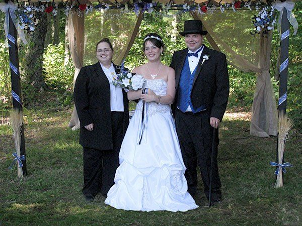 Bill and Theresa pose with Rev. Misty Urban after their handfasting wedding ceremony in the woods....
