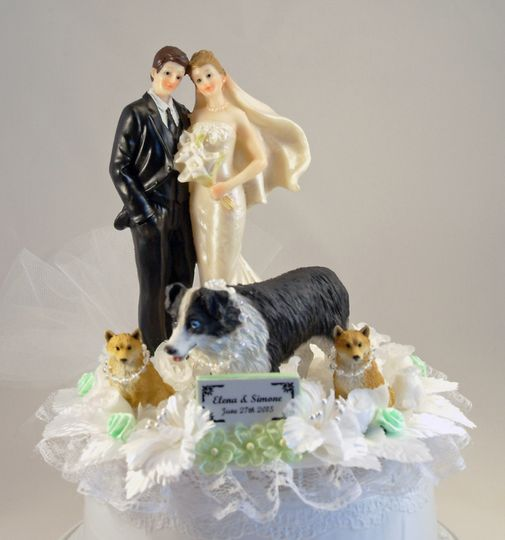 Our customized Yours Mine and Ours Pet cake topper featuring bride and groom with 3 dogs. Shown...