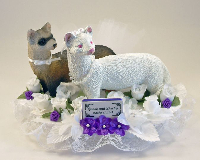 Our customized Heaven Scent Ferret bride and groom cake topper featuring sable groom and albino...