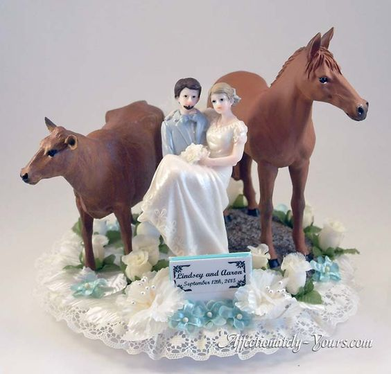 Our customized Romance Acres Pet cake topper featuring bride and groom with a cow and a horse....