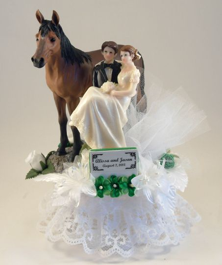 Our customized Two Trails Become One cake topper featuring bride and groom with 1 or 2 horses. Shown...