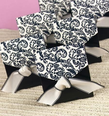"""white favor boxes with black satin ribbons are also available. Ribbons are ⅜"""" wide and are pre-cut..."""