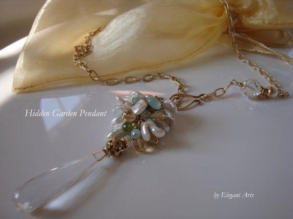 Hidden Garden Pendant - Crystal Quartz This pendant features an elongated crystal quartz teardrop...