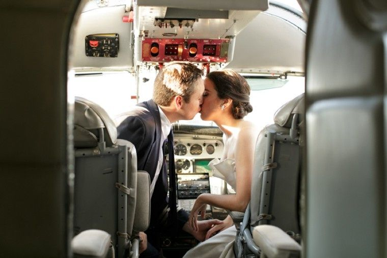 travel inspired wedding cockpit kiss