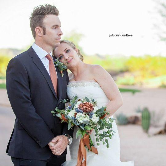 Resting her hands in his shoulder