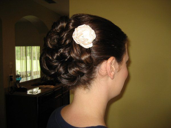 Bridal updo with a flower