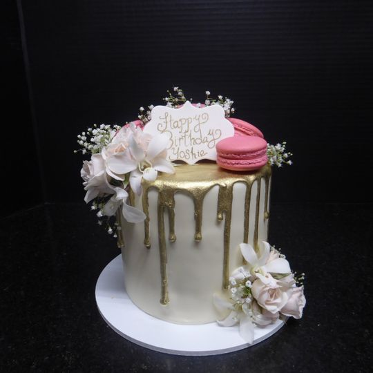 Gold drip birthday dake with french macarons and orchids