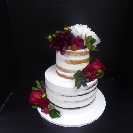 2 tier Semi Naked cake with fresh burgundy and white flowers