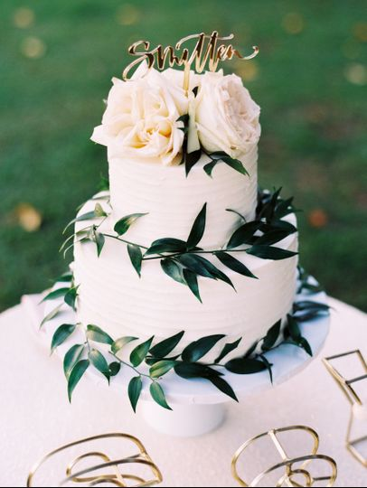 Simple 2 tier white cake with greenery and roses