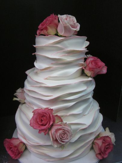 Fondant ruffles with gold edging and fresh pink roses