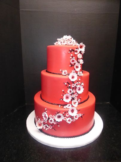 3 tier red fondant with sugar cherry blossoms