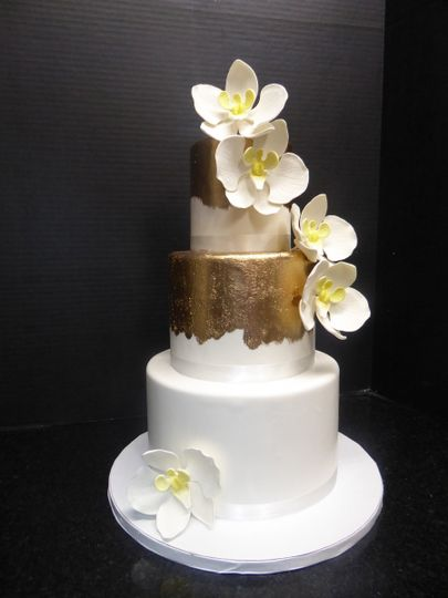3 tier fondant with gold brush detail and sugar moth orchids