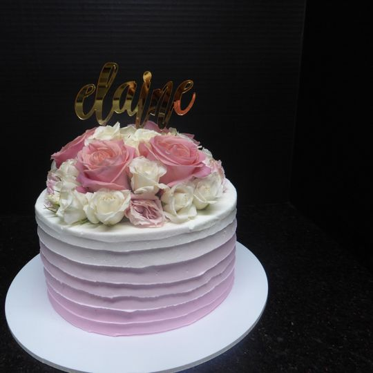 One tier Ombre light pink with horizontal spatula marks and fresh roses