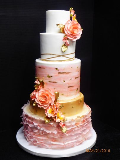 Five tier Fondant cake with blush pinks, white, and gold accents, sugar roses and flower accents.