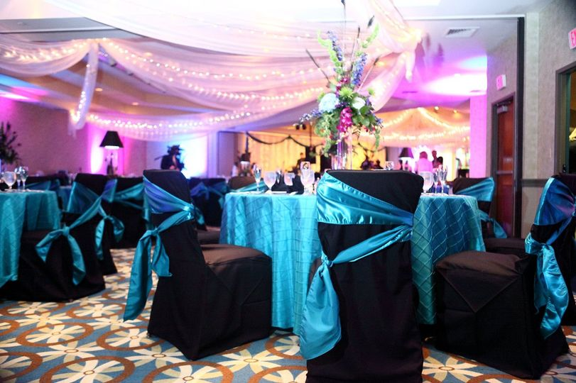 Black chairs with blue bows