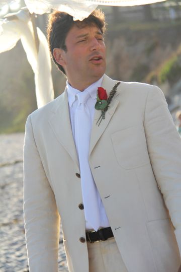 The groom in a cream blazer