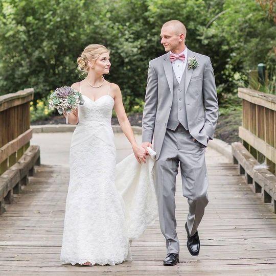 Happy couple walking on bridge