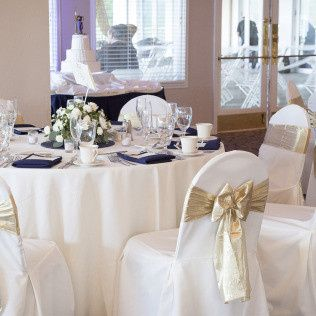 White and gold table and chair setup