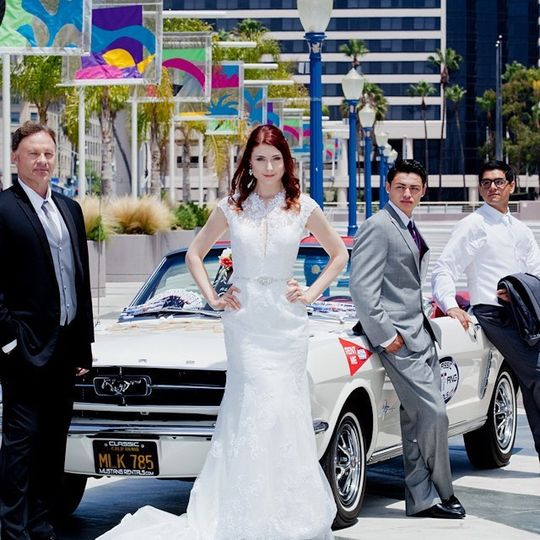 Wedding party with vintage car