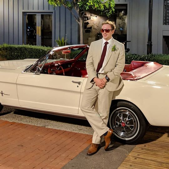 Man posing with vanilla mustang