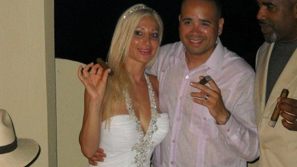 The bride and groom enjoying Don Pedro Cigars