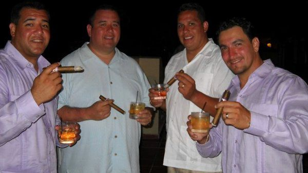 Wedding guests enjoying freshly rolled Don Pedro Cigars with special blends and tobacco from Puerto...