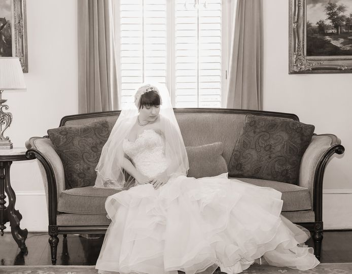 Bride seated on a couch - John Marquez Photography