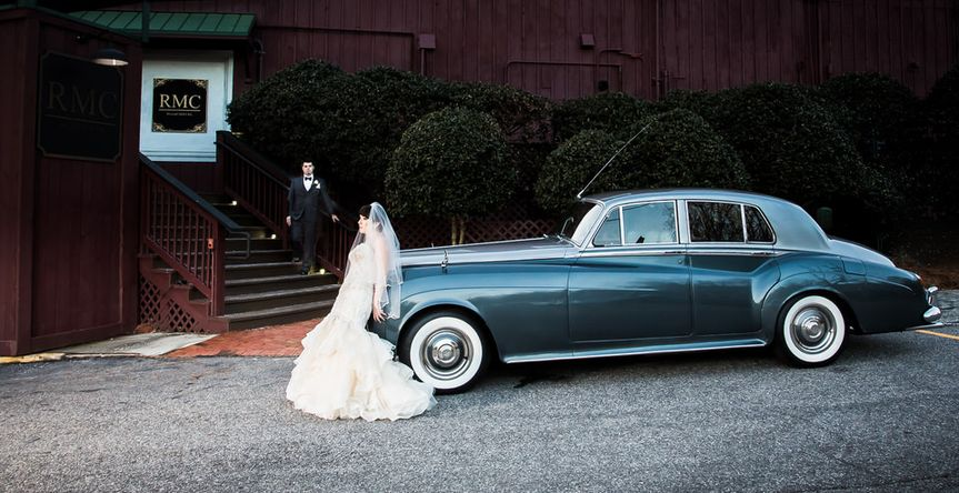 Bride standing in front of a classic car - John Marquez Photography
