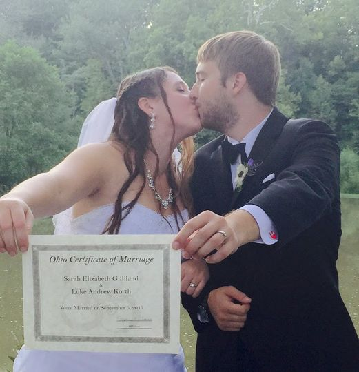 Showing off their wedding certificate