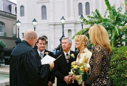 Chaplain Schwehm and couple gettting married in Jackson Square, New Orleans