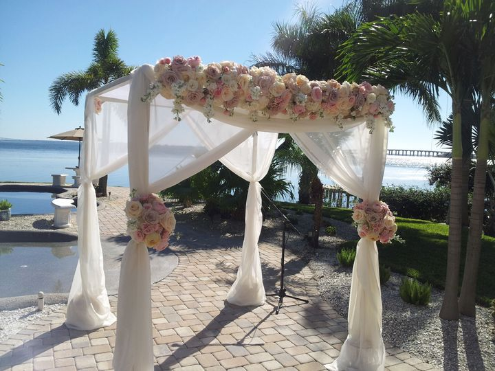 Love this chuppah with soft pinks and ivorys.