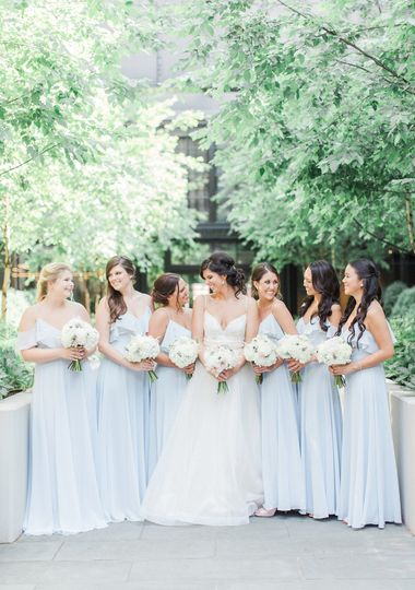 Bridal party posing outside