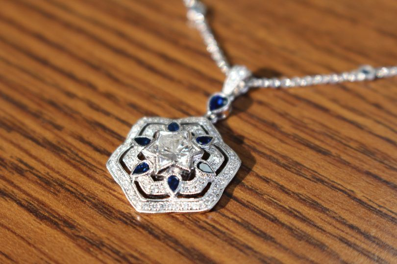 "This pendant was designed to embrace a 2 carat diamond ""star of david""  Only one cut this size in..."