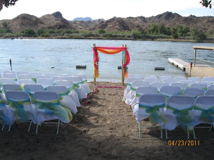 Bamboo Arch w/ Tropical colored Organza Swag on the river in Parker CA