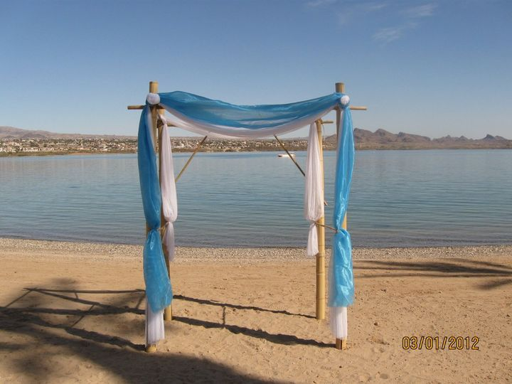 """Tropical Arch of Bamboo set on the """"Beach"""" on the lake at the Nautical Resort in Lake Havasu City..."""