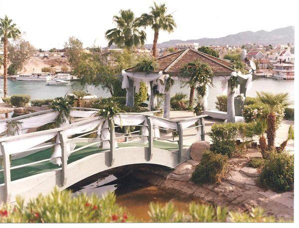 Gazebo and bridge decor for the walk down the aisle, view of beautiful Lake Havasu and the...