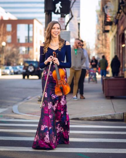 Walking across the street with the violin