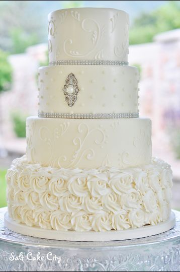 all white piped wedding cake with buttercream
