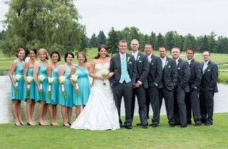The newlyweds with the wedding attendants