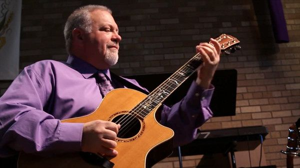 Jim Olsen on his guitar