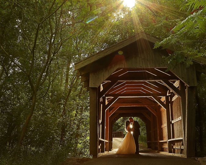 Couple secluded by undercover bridge - Jdog Studios