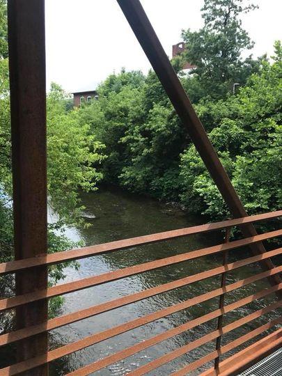 Walking bridge across the river mere steps away