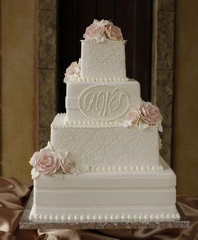 Four layered white wedding cake