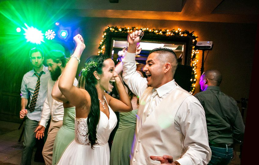 The bride and groom along with their wedding guests dancing the night away! Arizona Mobile DJ knows...
