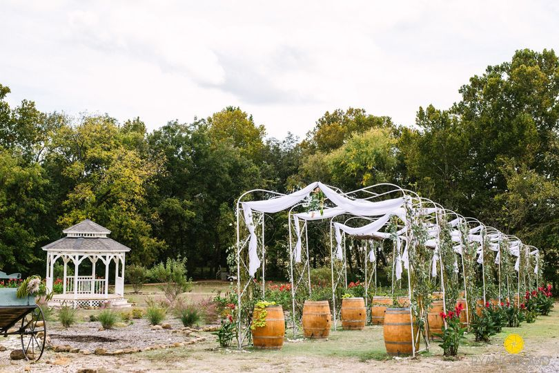 Wine Barrel Trellis Row with Curly Willow, Lace, and Roses...Gazebo and Walking Gardens